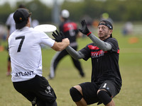 FRISCO, TX: Daniel Kantor (Truck Stop #1) breaks up a pass to Jay Clark (Chain Lightning #7) in bracket play at the USA Ultimate Men's National Championships. Friday, October 18, 2013. ©  Brian Cannif