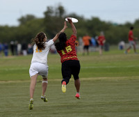 FRISCO, TX: Marjo Poindexter (Showdown #15) ran down a long pass to Kate Schlag (Nightlock #11) in bracket play at the USA Ultimate National Championships. Friday, October 18, 2013. ©  Brian Canniff f