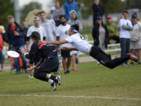 FRISCO, TX: Markham Shofner (Truck Stop #90) catches a pass as defender Bryon Liu (Chain Lightning #8) bids high in bracket play at the USA Ultimate Men's National Championships. Friday, October 18, 2