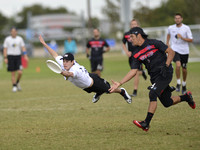 FRISCO, TX: Alan Kolick (Truck Stop #99) retains possession with an endzone layout against Chain Lightning in pool play at the USA Ultimate National Championships. Friday, October 18, 2013. ©  Brian C