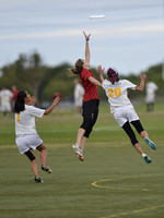 FRISCO, TX: Cara Crouch (Showdown #5) skies for an overthrown pass while covered by Sharon Tseng (Nightlock #1) and Briana Cahn (Nightlock #20) at the USA Ultimate National Championships. Friday, Octo